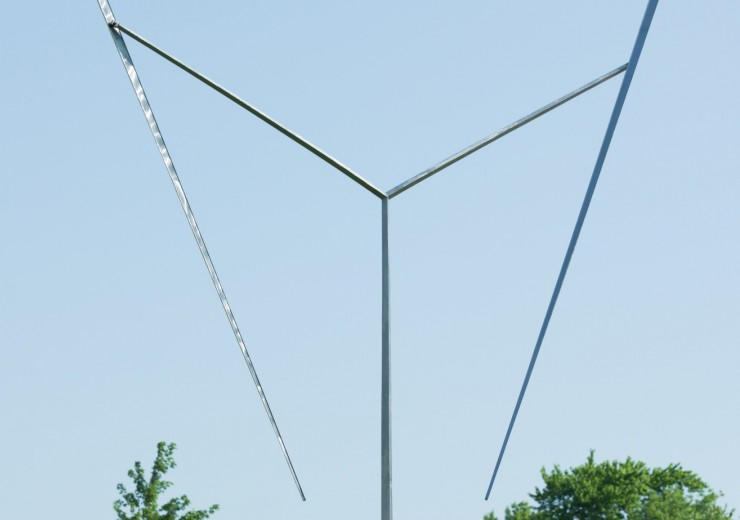 Thin, stainless steel pole reaching 36 feet high with two poles at the top jutting out to the sides, with a pole pointing downward from both.