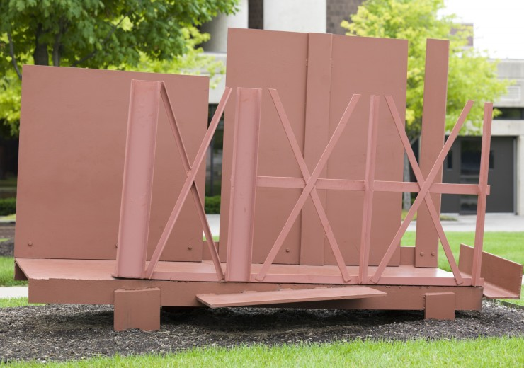 Statue made from sheet steel, steel beams with red paint