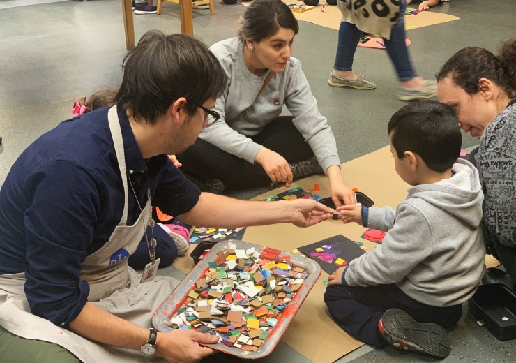 Detroit Institute of Arts Studio Teacher assisting children with art-making