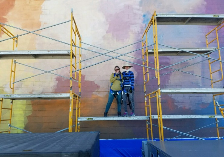 DIA studio staff Ani Garabedian and Stephanie Sucaet-Felczak pose in front of a section of the Lake Orion PIPA mural