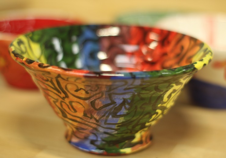 The finished rainbow colored bowl with a black overlay design