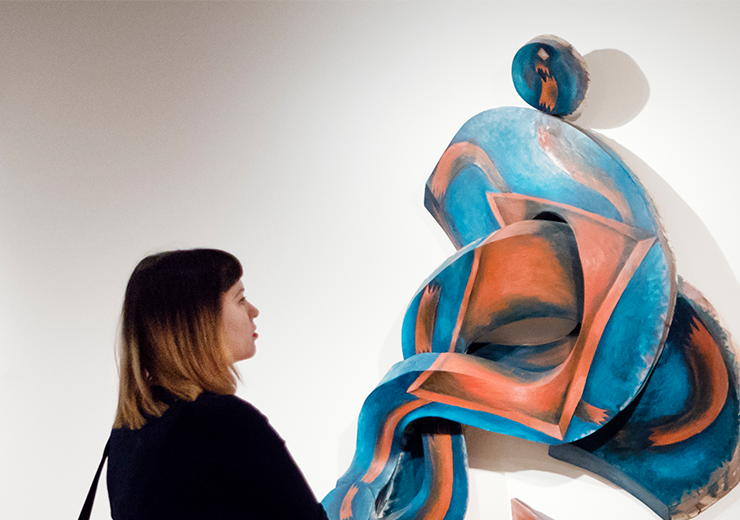 Woman standing and looking at modern art