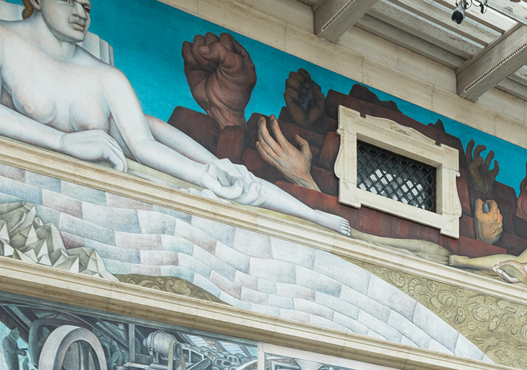 Groups of patrons looking around at the Detroit Industry Murals in Rivera Court