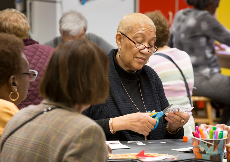 Seniors working in the art-making studio during a Thursdays at the Museum program at the DIA