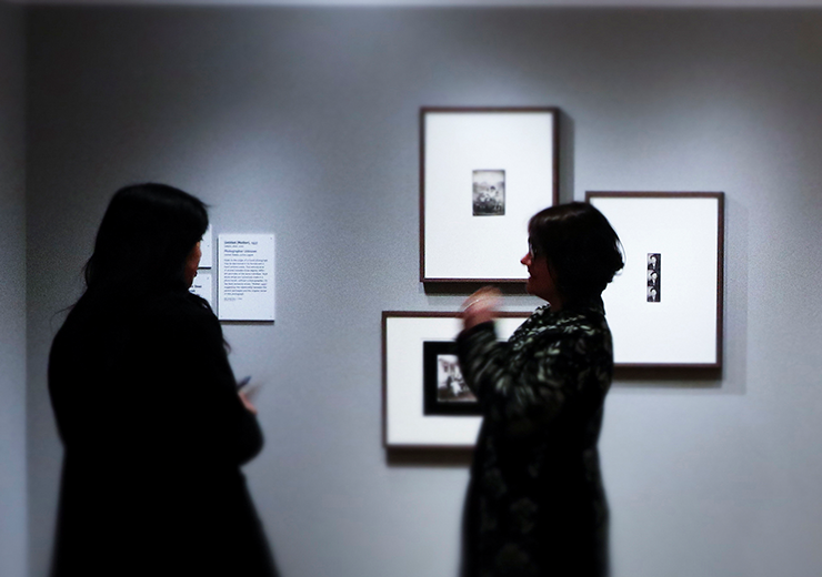 Two women talking in a prints and drawings gallery