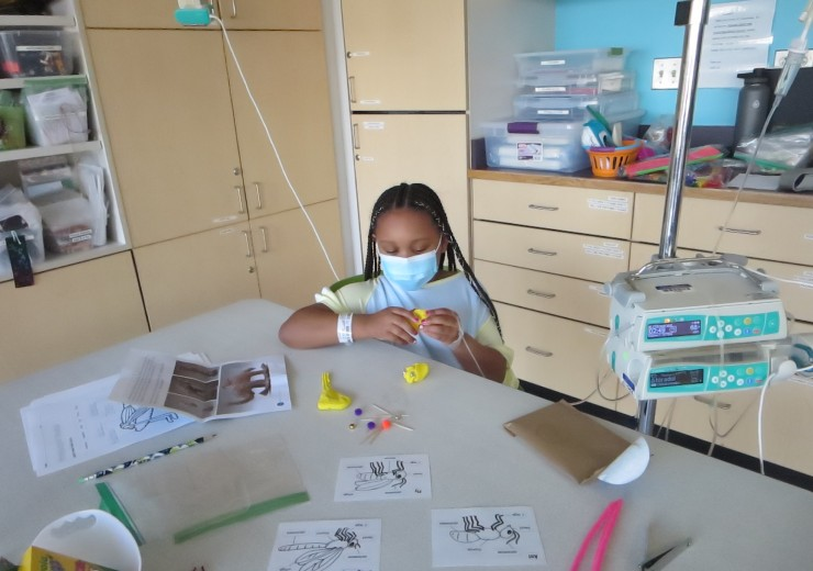 A patient working on their art-making project