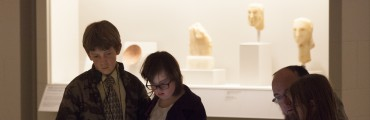 Visitors looking at art.