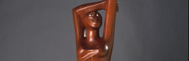 """Homage to Black Women Poets,"" 1984, Elizabeth Catlett, mahogany. Detroit Institute of Arts"