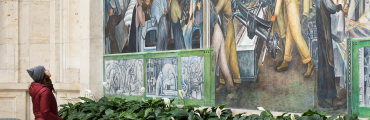 A woman observing the Diego Rivera Murals