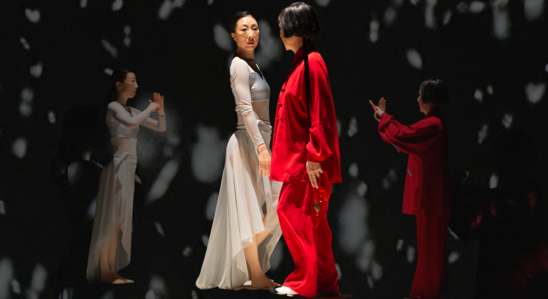 Two women stand facing each other, one in all red and one in all white, as other images of themselves in conversation are superimposed on the background.