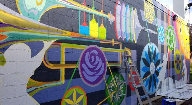 Colorful mural by the Detroit Institute of Arts in progress in Eastpointe, MI