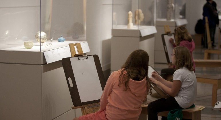 A few children drawing at easels