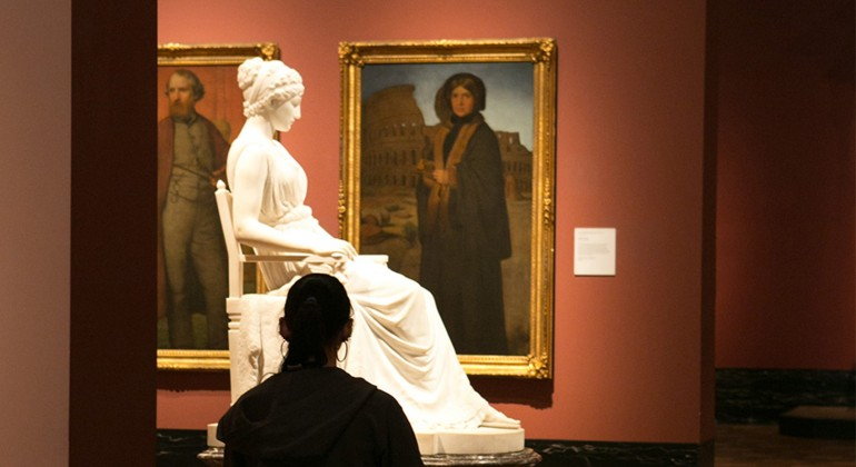 A woman drawing in the American galleries