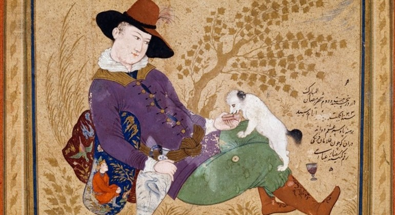 A painting of a person, in masculine dress, sitting on the ground near a tree. They're holding a vase and feeding a small white dog out of their hand.