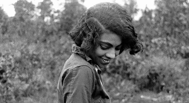 A still of a woman smiling in black and white