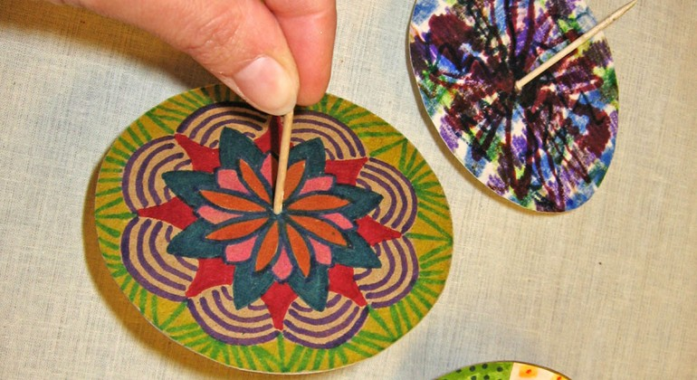 Folk art spinners made with paper and toothpicks