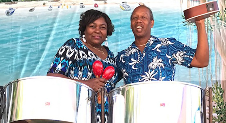 Two members of Gratitude Steel Band with their instruments