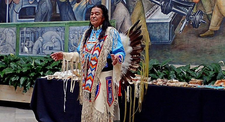 Reg Pettibone, in traditional Native American dress, performs in the Detroit Institute of Arts' Rivera Court