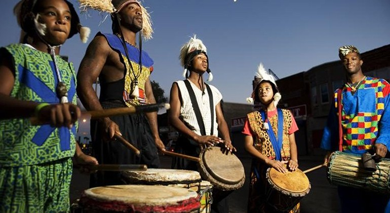 Drum line dressed in traditional African clothing