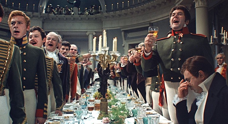 Military men singing at a dinner