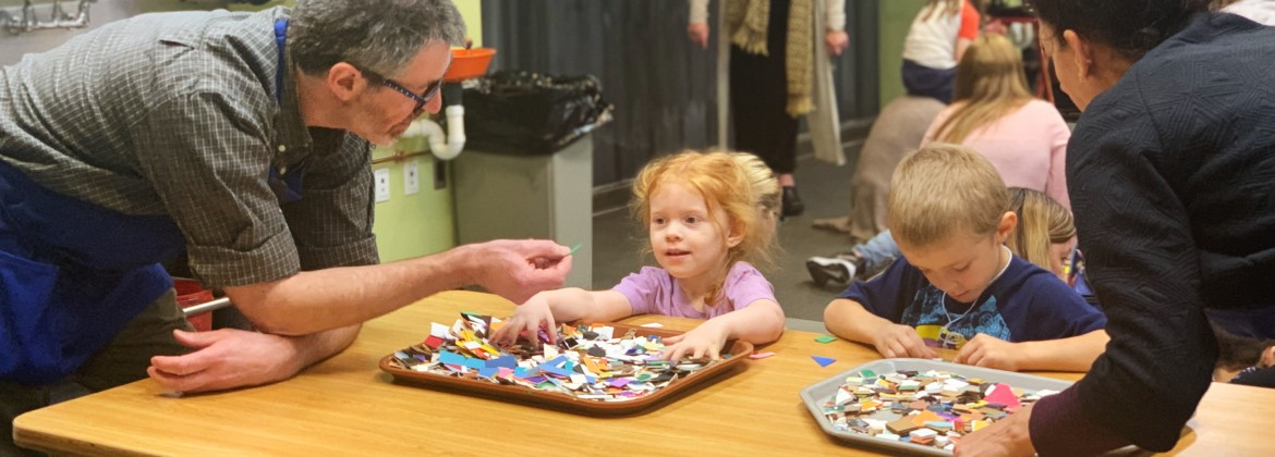 Detroit Institute of Arts Studio Teachers assisting children with art-making