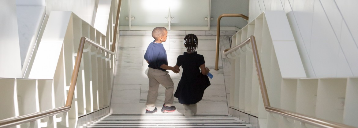 Kids walking down the stairs at the DIA