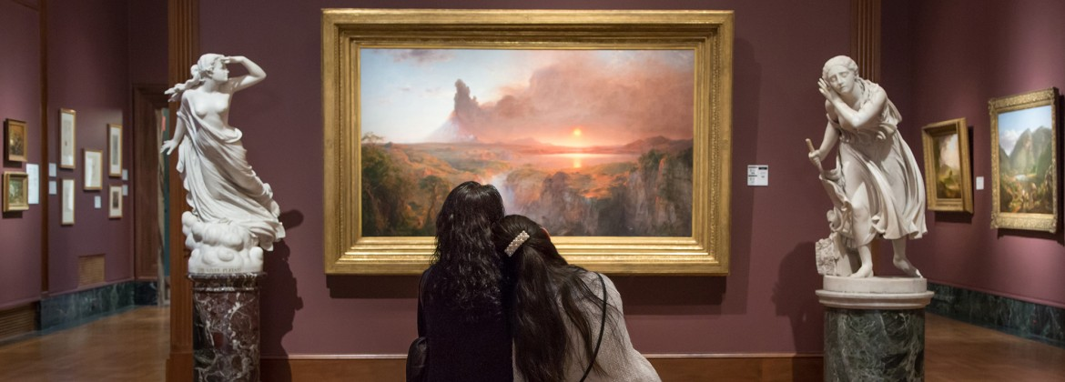Two visitors view a painting at DIA