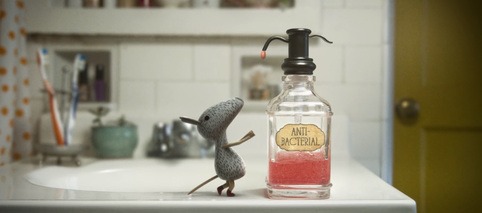 A still from The Perfect Houseguest, featuring a mouse looking at a bottle of hand sanitizer