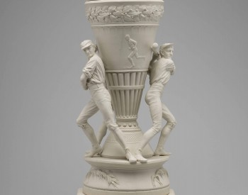 Thin, white vase adorned with baseball players. View 1
