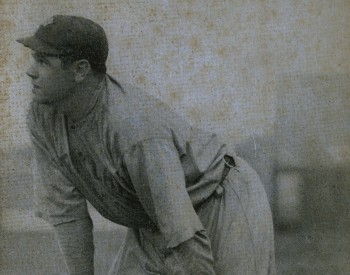 Babe Ruth bending over with his hands on his knees during a game