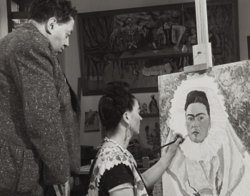 Bernard G. Silberstein (American, 1905–1999), Diego Rivera Watching Frida Kahlo Paint a Self Portrait, c. 1940, printed 1981. Gelatin silver print, 9 5/8 × 7 5/8 in. (24.4 × 19.4 cm). Detroit Institute of Arts, Gift of the artist, F81.484.