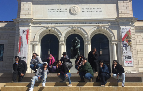 Teen Arts Council members sitting on the front steps of the DIA during the Star Wars and the Power of Costume exhibition
