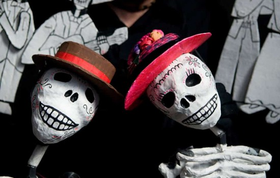 Two Day of the Dead skeleton puppets