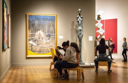 Four women sitting and drawing in the Modern Galleries