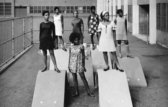 Kwame Brathwaite, Photo shoot at a public school for one of the AJASS-associated modeling groups that emulated the Grandassa Models and began to embrace natural hairstyles. Harlem, ca. 1966; from Kwame Brathwaite: Black Is Beautiful (Aperture, 2019)