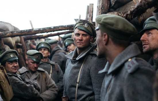 Many men in military uniforms standing in military trenches with serious and worried expressions.