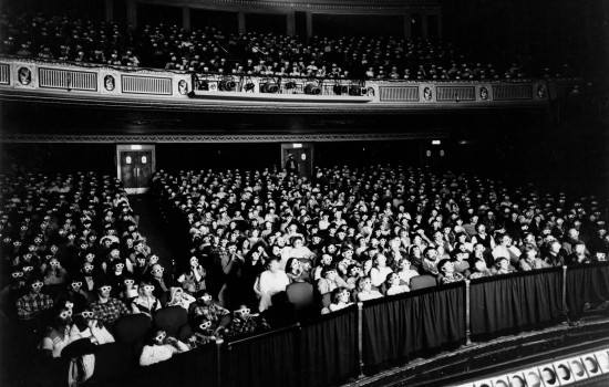 A black and white photograph of a crowded Detroit Film Theatre