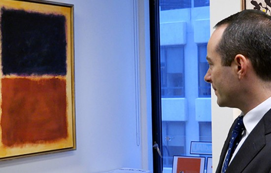 A masculine presenting person in a suit is looking at a forged Rothko painting, with a forged Jackson Pollock behind them.