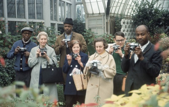 """Untitled (Group Portrait with Cameras, Belle Isle Conservatory, Detroit),"" around 1970, attributed to Allen Stross, color transparency film. Detroit Institute of Arts"