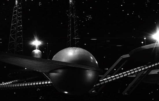 A dark, black and white image of indiscriminate space age architecture