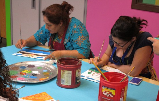 Two women painting in the DIA art-making studio