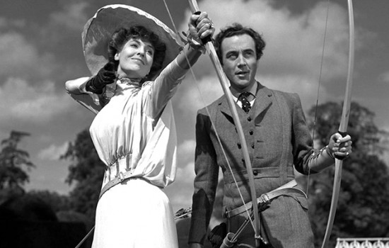 A man and woman shooting bows and arrows