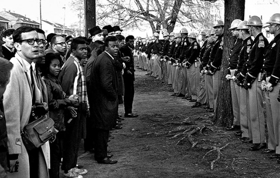 A still from King: A Filmed Record… Montgomery to Memphis of a standoff between a line of police and a line of protesters