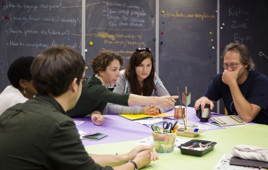 A group of teachers around a table in the Art-Making Studio