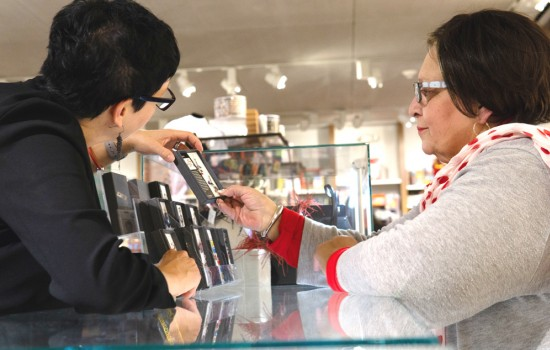 Two women looking at a necklace in the DIA Shop