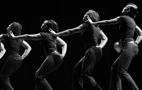 Black and white photo of step dancers in sync