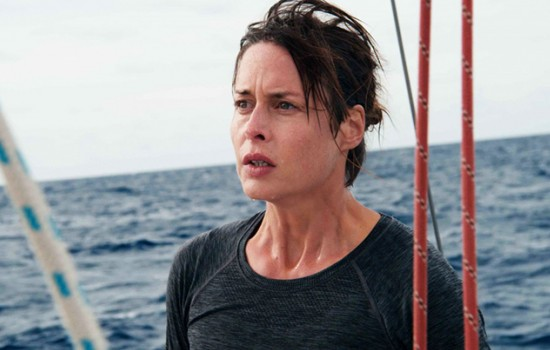 A woman with a stern expression on a boat