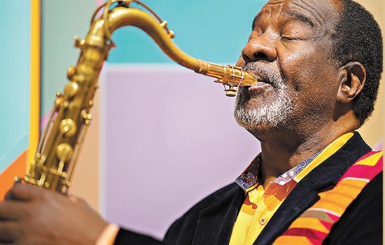 A close up shot of Wendell Harrison playing saxophone