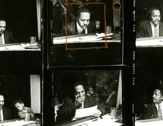 Photographs of a man and a boy at a piano