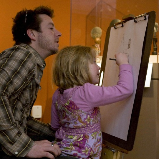 Dad and Young Daughter Drawing in the Galleries at the DIA